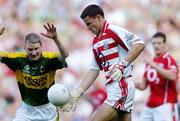 20 August 2006; Alan Quirke, Cork, in action against Mike Frank Russell, Kerry. Bank of Ireland All-Ireland Senior Football Championship Semi-Final, Kerry v Cork, Croke Park, Dublin. Picture credit: Brian Lawless / SPORTSFILE