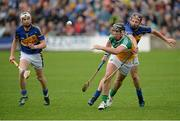12 July 2014; Shane Dooley, Offaly, in action against Paddy Stapleton, right, and Brendan Maher, left, Tipperary. GAA Hurling All-Ireland Senior Championship Round 2, Tipperary v Offaly, O'Moore Park, Portlaoise, Co. Laois. Picture credit: Piaras Ó Mídheach / SPORTSFILE