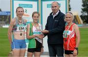 19 July 2014; Jim Dowdall, CEO, GloHealth, presents the gold medal for the Women's 5000m to Fionnuala Britton, Kilcoole AC, Wicklow, in the company of silver medallist Maria McCambridge, left, Dundrum South Dublin AC, and bronze medallist Ann Marie McGlynn, Lifford AC, Donegal. GloHealth Senior Track and Field Championships, Morton Stadium, Santry, Co. Dublin. Picture credit: Brendan Moran / SPORTSFILE