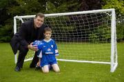 23 August 2006; Technical Director of the FAI and Irish goalkeeping legend Packie Bonner with Dylan Murray, age 8, from Lucan, Dublin, one of two winners of the 'Pepsi Dream Prize' - the chance to meet international footballing hero Thierry Henry, a competition run in conjunction with the Pepsi FAI Summer Soccer Schools. The other winner was Josh Lydon, age 8, from Galway, who was unable to make the photocall. St. Stephens Green, Dublin. Picture credit: Brendan Moran / SPORTSFILE