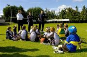 24 August 2006; Dublin footballer and hurler Conal Keaney, right, Paraic McDonald, Director of Coaching, Kilmacud Crokes GAA Club, and Declan Moran, left, Vhi, speak to young players at the announcement by the GAA that a record 75,000 children attended the Official GAA Vhi Cúl Camps this summer. Kilmacud Crokes GAA Club, Stillorgan, Dublin. Picture credit; Matt Browne / SPORTSFILE