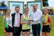 20 July 2014; Jim Dowdall, CEO, GloHealth, right, presents the gold medal for the Women's 1500m to Ciara Mageean, UCD AC, Dublin, in the company of silver medallist Fionnuala Britton, Kilcoole AC, Wicklow, bronze medallist Kerry O'Flaherty, Newcastle & District AC, Down, and Ciarán Ó Catháin, President, Athletics Ireland. GloHealth Senior Track and Field Championships, Morton Stadium, Santry, Co. Dublin. Picture credit: Brendan Moran / SPORTSFILE