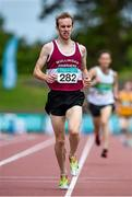 20 July 2014; Mark Christie, Mullingar Shamrocks AC, Westmeath, crosses the line to finish in second place in the Men's 5000m Final. GloHealth Senior Track and Field Championships, Morton Stadium, Santry, Co. Dublin. Picture credit: Brendan Moran / SPORTSFILE
