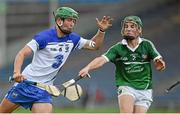 22 July 2014; Shane Ryan, Waterford, in action against Sean Finn, Limerick. Electric Ireland Munster GAA Hurling Minor Championship Final Replay, Waterford v Limerick, Semple Stadium, Thurles, Co. Tipperary. Picture credit: Diarmuid Greene / SPORTSFILE