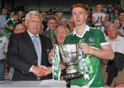 22 July 2014; Limerick captain Cian Lynch is presented with the cup by Jerry O'Sullivan, Munster Council Vice-Chairman. Electric Ireland Cup Presentation at Munster GAA Hurling Minor Championship Final Replay, Limerick v Waterford, Semple Stadium, Thurles, Co. Tipperary. Picture credit: Diarmuid Greene / SPORTSFILE