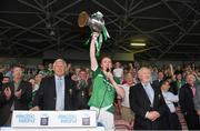 22 July 2014; Limerick captain Cian Lynch lifts the cup in the company of, from left to right, Paul Stapleton, from Electric Ireland, Jerry O'Sullivan, Munster Council Vice-Chairman, and Robert Frost, Munster Council Chairman. Electric Ireland Cup Presentation at Munster GAA Hurling Minor Championship Final Replay, Limerick v Waterford, Semple Stadium, Thurles, Co. Tipperary. Picture credit: Diarmuid Greene / SPORTSFILE