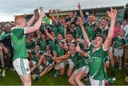 22 July 2014; Limerick captain Cian Lynch and team-mates celebrate with the cup after victory over Waterford. Electric Ireland Munster GAA Hurling Minor Championship Final Replay, Waterford v Limerick, Semple Stadium, Thurles, Co. Tipperary. Picture credit: Diarmuid Greene / SPORTSFILE