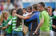 22 July 2014; Limerick's Colin Ryan is congratulated by supporters after victory over Waterford. Electric Ireland Munster GAA Hurling Minor Championship Final Replay, Waterford v Limerick, Semple Stadium, Thurles, Co. Tipperary. Picture credit: Diarmuid Greene / SPORTSFILE