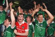 22 July 2014; Limerick players, including goalkeeper Eoghan McNamara, centre, celebrate after victory over Waterford. Electric Ireland Munster GAA Hurling Minor Championship Final Replay, Waterford v Limerick, Semple Stadium, Thurles, Co. Tipperary. Picture credit: Diarmuid Greene / SPORTSFILE