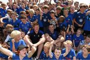 23 July 2014; Leinster players Tom Denton and Jamie Heaslip with kids from The Herald Leinster Rugby Summer Camps in Seapoint RFC, Killiney, Co. Dublin. Picture credit: Matt Browne / SPORTSFILE