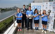 24 July 2014; Representatives of Dublin's recent Leinster Championship winning football teams paid a visit to the offices of Dublin GAA sponsor AIG today to celebrate their success. Dublin teams at minor, Under-21 and senior level in both male and female codes have secured provincial honours already this summer with the Under-21 sides both going on to win All Ireland titles. Players in attendance were, from left, Martha Byrne, U-21 Ladies Footballer, Lorcan Molloy, U-21 Footballer, Paddy Andrews Senior Footballer, Lyndsey Davey, Ladies Senior Footballer, and Aoife Curran, Ladies Minor Footballer, who were all on hand for the event with the silverware they have won. AIG has also launched exclusive car, home and travel insurance rates for GAA club members at www.aig.ie/dubs. Picture credit: Brendan Moran / SPORTSFILE
