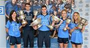 24 July 2014; Representatives of Dublin's recent Leinster Championship winning football teams paid a visit to the offices of Dublin GAA sponsor AIG today to celebrate their success. Dublin teams at minor, Under-21 and senior level in both male and female codes have secured provincial honours already this summer with the Under-21 sides both going on to win All Ireland titles. Players in attendance were, from left, Lyndsey Davey, Ladies Senior Footballer, Lorcan Molloy, U-21 Footballer, Paddy Andrews Senior Footballer, Martha Byrne, U-21 Ladies Footballer, and Aoife Curran, Ladies Minor Footballer, who were all on hand for the event with the silverware they have won. AIG has also launched exclusive car, home and travel insurance rates for GAA club members at www.aig.ie/dubs. Picture credit: Brendan Moran / SPORTSFILE