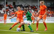 24 July 2014; Amy O'Connor, Republic of Ireland, in action against Kim Mourmans, left, and Lucie Akkerman, the Netherlands. UEFA European Women's U19 Championship, Republic of Ireland v the Netherlands. Mjøndalen Stadion, Nedre Eiker, Norway. Picture credit: Stephen McCarthy / SPORTSFILE
