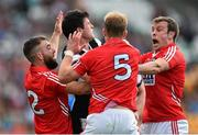 26 July 2014; Pat Hughes, Sligo, is put under pressure by, from left, Colm O'Driscoll, Michael Shields, and James Loughrey, Cork. GAA Football All Ireland Senior Championship, Round 4A, Cork v Sligo. O'Connor Park, Tullamore, Co. Offaly. Picture credit: Ramsey Cardy / SPORTSFILE