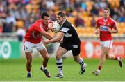 26 July 2014; Brian Curran, Sligo, in action against Thomas Clancy, Cork. GAA Football All Ireland Senior Championship, Round 4A, Cork v Sligo. O'Connor Park, Tullamore, Co. Offaly. Picture credit: Ramsey Cardy / SPORTSFILE