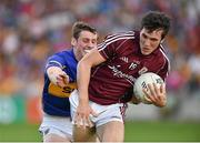 26 July 2014; Daithí Burke, Galway, in action against Conor Sweeney, Tipperary. GAA Football All Ireland Senior Championship, Round 4A, Galway v Tipperary. O'Connor Park, Tullamore, Co. Offaly. Picture credit: Barry Cregg / SPORTSFILE