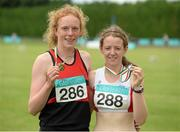 26 July 2014; Emma O'Brien, from Inbhear Dee AC, Wicklow Town, who won the Girls U16 800m with second place Rachael Browne, from Greystones & District AC, Co. Wicklow. GloHealth Juvenile Track and Field Championships, Tullamore Harriers AC, Tullamore, Co. Offaly. Picture credit: Matt Browne / SPORTSFILE