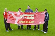 13 September 2006; St. Patrick's Athletic F.C. players from left, Luke Fitzpatrick, Sean O'Connor and Brendan Clarke, with Patricia Byrne, The Samaritans, and Pat Teehan, centre, during a photocall to support the recently launched Samaritans Teenhelp service, a community initative to provide help and emotional support for suicidal teenagers. Richmond Park, Dublin. Picture credit: Matt Browne / SPORTSFILE