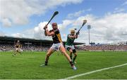 27 July 2014; Andrew Shore, Wexford, clears the balls despite the challenge of David Breen, Limerick. GAA Hurling All Ireland Senior Championship Quarter-Final, Limerick v Wexford. Semple Stadium, Thurles, Co. Tipperary. Picture credit: Dáire Brennan / SPORTSFILE