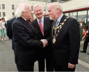 30 July 2014; President of Ireland Michael D. Higgins is greeted on his arrival for the days races by Mayor of Galway City Donal Lyons, right, and  Terry Cunningham, centre, Chairman of Galway Race Committee. Galway Racing Festival, Ballybrit, Co. Galway. Picture credit: Barry Cregg / SPORTSFILE