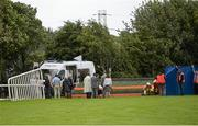 30 July 2014; Republic of Ireland manager Martin O'Neill, centre in grey suit, and his friend Justin Carthy, in beige overcoat, Head of Racecource Management for Ladbrokes and owner of Break My Mind, look on as jockey Sarah Lynam is attended to after Mr Carthy's horse had fallen in the Grab A Grand With Tote Maiden. Galway Racing Festival, Ballybrit, Co. Galway. Picture credit: Ray McManus / SPORTSFILE