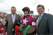 30 July 2014; Jockey Shane Shortall in the winners enclosure with trainer Noel Meade, left, and Eddie O'Leary brother of owner Michael O'Leary, after he rode Road to Riches to win thetote.com Galway Plate. Galway Racing Festival, Ballybrit, Co. Galway. Picture credit: Ray McManus / SPORTSFILE