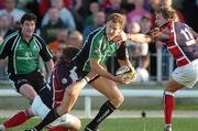 15 September 2006; Matt Mostyn, Connacht, is tackled by Mathew Watkins and Darren Daniel, Llanelli Scarlets. Magners Celtic League 2006 - 2007, Connacht v Llanelli. Picture credit; Ray Ryan / SPORTSFILE