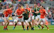 2 August 2014; Damien Carroll, Meath, in action against Mark Shields, Stefan Campbell, Stephen Harold and Andy Mallon, Armagh. GAA Football All-Ireland Senior Championship, Round 4B, Meath v Armagh, Croke Park, Dublin. Picture credit: Oliver McVeigh / SPORTSFILE