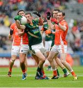 2 August 2014; Damien Carroll, Meath, in action against Stefan Campbell, Stephen Harold and Andy Mallon , Armagh. GAA Football All-Ireland Senior Championship, Round 4B, Meath v Armagh, Croke Park, Dublin. Picture credit: Oliver McVeigh / SPORTSFILE