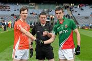 3 August 2014; Armagh captain Caolán McConville shakes hands with Mayo captain Cian Hanley ahead of the game in the presence of match referee Paddy Neilan. Electric Ireland GAA Football All Ireland Minor Championship, Quarter-Final, Mayo v Armagh, Croke Park, Dublin. Picture credit: Ray McManus / SPORTSFILE