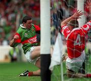 22 August 1999; Barry Loftus of Mayo scores his side's goal despite the effort of Finbarr Crowley of Cork during the All-Ireland Minor Football Championship Semi-Final match between Cork and Mayo at Croke Park in Dublin. Photo by Aoife Rice/Sportsfile