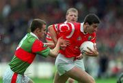 22 August 1999; Bernard Collins of Cork in action against Paraic Kelly of Mayo during the All-Ireland Minor Football Championship Semi-Final match between Cork and Mayo at Croke Park in Dublin. Photo by Aoife Rice/Sportsfile