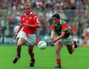 22 August 1999; Conor Moran of Mayo in action against Conrad Murphy of Cork during the All-Ireland Minor Football Championship Semi-Final match between Cork and Mayo at Croke Park in Dublin. Photo by Matt Browne/Sportsfile