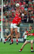 22 August 1999; Damien Delaney of Cork in action against Gavin Duffy of Mayo during the All-Ireland Minor Football Championship Semi-Final match between Cork and Mayo at Croke Park in Dublin. Photo by Matt Browne/Sportsfile