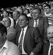 3 September 1989; Former Republic of Ireland manager Jack Charlton, accompanied by Maurice Setters and Joe Delaney, watch on during the All-Ireland Senior Hurling Championship Final between Tipperary and Antrim at Croke Park in Dublin. Photo by Ray McManus/Sportsfile