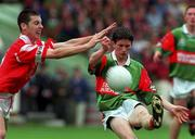 22 August 1999; John Moran of Mayo in action against Ronan Curran of Cork during the All-Ireland Minor Football Championship Semi-Final match between Cork and Mayo at Croke Park in Dublin. Photo by Matt Browne/Sportsfile