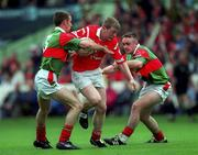 22 August 1999; John Flavin of Cork in action against Paraic Kelly, left, and John Brogan of Mayo during the All-Ireland Minor Football Championship Semi-Final match between Cork and Mayo at Croke Park in Dublin. Photo by Ray McManus/Sportsfile