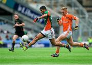 3 August 2014; Sharoize Akram, Mayo, in action against Kyle Mallon, Armagh. Electric Ireland GAA Football All Ireland Minor Championship, Quarter-Final, Mayo v Armagh, Croke Park, Dublin. Picture credit: Cody Glenn / SPORTSFILE