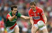 3 August 2014; Colm O'Neill, Cork, in action against Ger Cafferkey, Mayo. GAA Football All-Ireland Senior Championship, Quarter-Final, Mayo v Cork, Croke Park, Dublin. Picture credit: Stephen McCarthy / SPORTSFILE