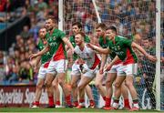 3 August 2014; Mayo players, from left, Keith Higgins, Jason Gibbons, Ger Cafferkey, Robert Hennelly, Séamus O'Shea, and Jason Doherty defend their goal from a Cork free kick during injury time. GAA Football All-Ireland Senior Championship, Quarter-Final, Mayo v Cork, Croke Park, Dublin. Picture credit: Brendan Moran / SPORTSFILE