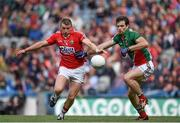 3 August 2014; Brian Hurley, Cork, in action against Ger Cafferkey, Mayo. GAA Football All-Ireland Senior Championship, Quarter-Final, Mayo v Cork, Croke Park, Dublin. Picture credit: Brendan Moran / SPORTSFILE