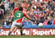 3 August 2014; Brian Hurley, Coek, scores his side's second goal of the game past Mayo's Ger Cafferkey. GAA Football All-Ireland Senior Championship, Quarter-Final, Mayo v Cork, Croke Park, Dublin. Picture credit: Brendan Moran / SPORTSFILE