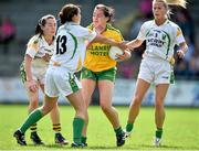 4 August 2014; Nicole McLaughlin, Donegal, in action against Kerry players, from left, Sarah Houlihan, Patrice Dennehy, 13, and Bernie Breen. TG4 All-Ireland Ladies Football Senior Championship Round 2 Qualifier, Donegal v Kerry, St Brendan's Park, Birr, Co. Offaly. Picture credit: Brendan Moran / SPORTSFILE