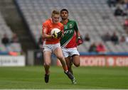 3 August 2014; Conor Cullen, Armagh, in action against Sharoize Akram, Mayo. Electric Ireland GAA Football All Ireland Minor Championship, Quarter-Final, Mayo v Armagh, Croke Park, Dublin. Picture credit: Ray McManus / SPORTSFILE