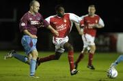 6 October 2006; St. Pat's Mark Rutherford in action against Paul Keegan, Drogheda. eircom League Premier Division, St. Patrick's Athletic v Drogheda United, Richmond Park, Dublin. Picture credit: Ray Lohan / SPORTSFILE