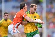 9 August 2014; Anthony Thompson, Donegal, in action against Andy Mallon, Armagh. GAA Football All-Ireland Senior Championship, Quarter-Final, Donegal v Armagh, Croke Park, Dublin. Picture credit: Stephen McCarthy / SPORTSFILE