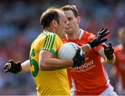 9 August 2014; Colm McFadden, Donegal, in action against Finnian Moriarty, Armagh. GAA Football All-Ireland Senior Championship, Quarter-Final, Donegal v Armagh, Croke Park, Dublin. Picture credit: Ray McManus / SPORTSFILE