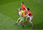 9 August 2014; Colm McFadden, Donegal, in action against Finnian Moriarty, left, and Aidan Forker, Armagh. GAA Football All-Ireland Senior Championship, Quarter-Final, Donegal v Armagh, Croke Park, Dublin. Picture credit: Dáire Brennan / SPORTSFILE