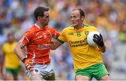9 August 2014; Colm McFadden, Donegal, in action against Finnian Moriarty, Armagh. GAA Football All-Ireland Senior Championship, Quarter-Final, Donegal v Armagh, Croke Park, Dublin. Picture credit: Stephen McCarthy / SPORTSFILE