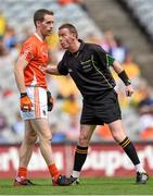 9 August 2014; Referee Joe McQuillan speaks with Finnian Moriarty, Armagh. GAA Football All-Ireland Senior Championship, Quarter-Final, Donegal v Armagh, Croke Park, Dublin. Picture credit: Stephen McCarthy / SPORTSFILE